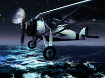 Night Flight. A vintage plane  crosses the ocean by night, under the moonlight Royalty Free Stock Image