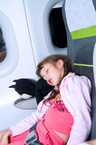 A child is sleeping in the plane during a flight Royalty Free Stock Photography