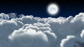 Night flight through cumulus clouds stock video footage