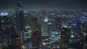 Night flight over Los Angeles downtown skyscrapers