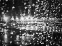 Night flight in the rain. View from the airplane raindrops window to the Helsinki Airport Stock Photos