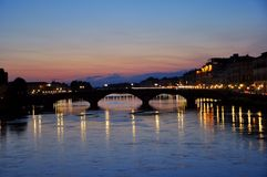 Night lights on the river in Florence city , Italy  Royalty Free Stock Image