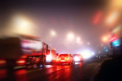 Night fog city cars red Royalty Free Stock Images