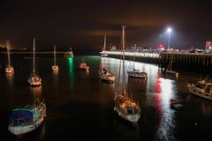 Night at Folkestone Harbour. Yachts at Folkestone Harbour at summer night royalty free stock photography