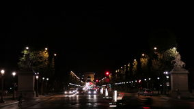 Night footage of the triumphal arch in Paris, France. An establishing shot of 'arc de triomphe' in Paris, France stock footage