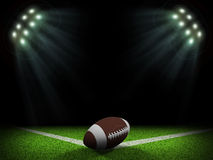 Night football arena illuminated by spotlights. Ball in the corner of field. Sports background Stock Photography
