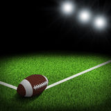 Night football arena illuminated by spotlights. Ball in the corner of field. Sports background Stock Photo