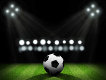 Night football arena illuminated by spotlights Royalty Free Stock Photos