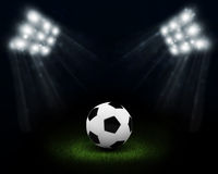 Night football arena illuminated by spotlights Royalty Free Stock Photo