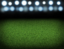 Night football arena illuminated by spotlights Stock Photo