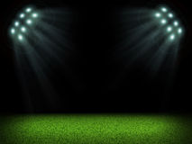 Night football arena illuminated by spotlights Stock Images