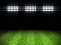 Night football arena illuminated by spotlights Royalty Free Stock Image