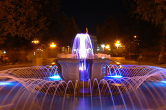 Night fountain. The fountain on the background of night city royalty free stock photos
