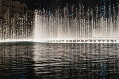 Night fountain, beautiful streams of water, light and music stock image