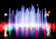 Night fountain. Coulorful fountain in the middle of the night Stock Images