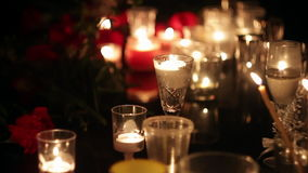 Night frames of the memorial with candles and flowers. The place of death in a terrorist attack. Grief and compassion of. People. Consequences of terrorist stock footage