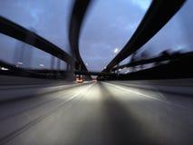 Night Freeway Interchange Motion. Towering freeway interchange ramps night driving view with abstract motion blur Stock Photo