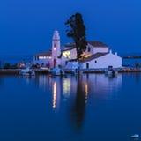 Night full moon scene of Vlacherna monastery and Pontikonisi isl Stock Photos