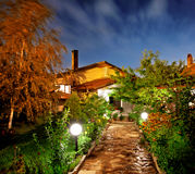Night garden. Trail and house in summer night garden Stock Image