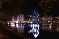 Night giants in Strasbourg. Strasbourg at night with Goliath cranes near river Stock Images