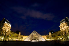 Night of the glass pyramid of louvre museum. The glass pyramid, which is designed by a famous architect, is one of the logos of paris. It became more attractive Royalty Free Stock Photos