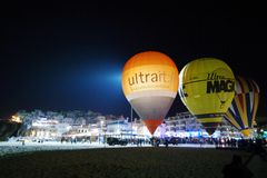 Night glow. Hot air balloon festival in Albufeira Stock Photography