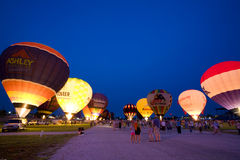 Night glow. Indianapolis, IN - August 5: hot air balloons light up the evening sky at the Indiana state fairgrounds Royalty Free Stock Photography