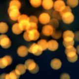 Night Glowing  lights with Defocused gold Bokeh Vintage backgrou Stock Photos