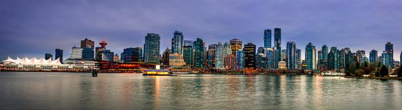 Night, glowing with multicolored lights, the megacity of the oce. An with huge buildings and blue sky Stock Photo
