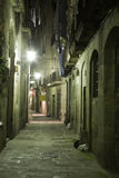 Night Gothic Quarter. Gothic quarter at night. Lane with lamp in Gothic quarter in Barcelona Stock Photo