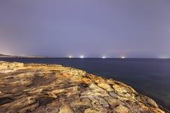 Night HDR long exposure photo of the shore of Malta, Saint Pauls Bay with ships on the horizon Royalty Free Stock Photo