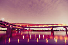 Night highway. With light reflections over Arakawa river in Tokyo Japan Stock Photo