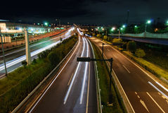 Night highway. Straight night highway with car's traces Stock Photo