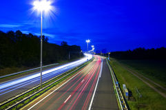 Night highway. Highway at night with rays of light passing by Royalty Free Stock Photography