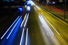 Night highway with car traffic. And blurry lights – long exposure – light lines – showing speed Royalty Free Stock Photos
