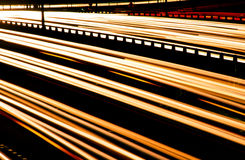 Blurred lights of cars on motorway Stock Photos