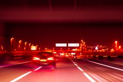 Night highway. Long exposure shot. Abstract blur image of road in the night time with bokeh for background. Speed effect royalty free stock image