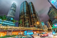 Night Hong Kong cityscape. Skyscrapers rise in sky. Pedder Street Tunnel road by Exchange Square building and IFC Tower. Hong Kong, China - January 29, 2016 Royalty Free Stock Images