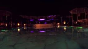 Night illuminated pool stock video