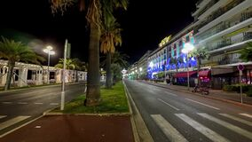 Night illuminated street Nice city traffic road street view 4k timelapse France. 4K stock footage