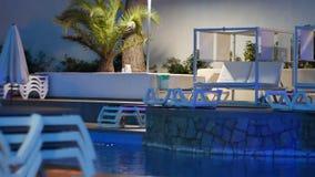 Night illuminated swimming pool at the resort stock video