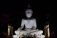 Night illumination Buddha statue at pagoda of Buddhist temple in Thailand. Night illumination Buddha statue at  ancient pagoda of Buddhist temple in Thailand Royalty Free Stock Image