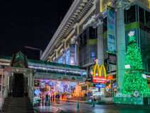 Night illumination of Christmas and Happy New Year 2015 festival. Night illumination of Christmas and New Year celebration 2015 at Ratchaprasong intersection in Royalty Free Stock Photo