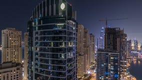 Night illumination of Dubai Marina aerial timelapse, UAE. Night illumination of Dubai Marina and JBR aerial timelapse, UAE. Modern skyscrapers and residential stock video footage