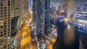 Night illumination of Dubai Marina aerial timelapse, UAE. Night illumination of Dubai Marina and JBR aerial timelapse, UAE. Modern skyscrapers and residential stock video