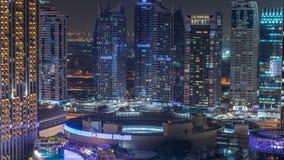 Night illumination of Dubai Marina aerial timelapse, UAE. Night illumination of Dubai Marina and JLT aerial timelapse, UAE. Modern skyscrapers and residential stock video footage