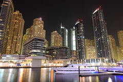 Night illumination at Dubai Marina. It is an artificial canal city, built along a two mile (3 km) stretch of Persian Gulf shoreline. Dubai, UAE royalty free stock images