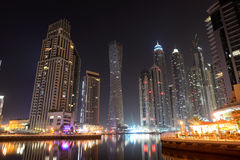 The night illumination at Dubai Marina and Cayan Tower Royalty Free Stock Images