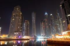 The night illumination at Dubai Marina and Cayan Tower royalty free stock images