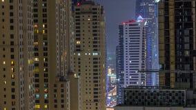 Night illumination of Dubai Marina aerial timelapse, UAE. Night illumination of Dubai Marina and JBR aerial timelapse, UAE. Modern skyscrapers and residential stock footage